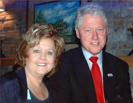 CEO Judee Mann meets with President Bill Clinton to speak about the unique needs of Eastern KY